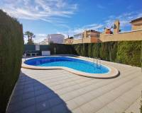 sun terrace around community swimming pool enjoyed with property for sale